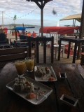 Sushi and passion fruit cocktails on the water